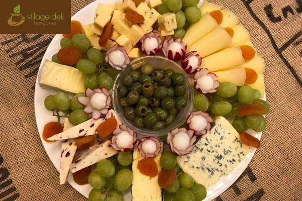 Tasty gourmet meat, cheese & marinated olive antipasto platter catering at the Village Deli Bongaree